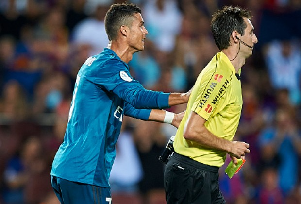 Real Madrid superstar Cristiano Ronaldo was seen shoving the referee after  he was shown a red card against FC Barcelona in El Clasico on Sunday. 574687789