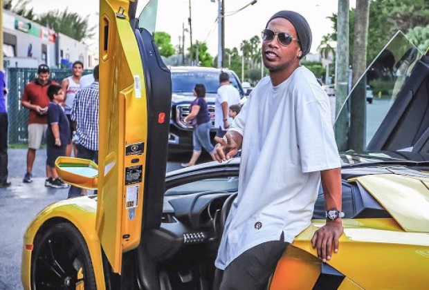 10 Images Of Ronaldinho's Extravagant Car Collection Over The Years